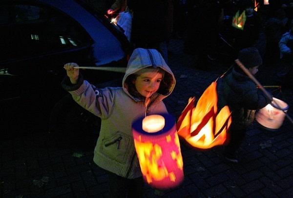 child with lantern