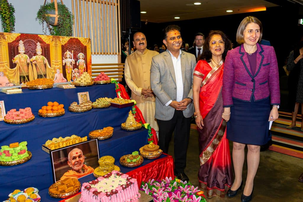 NSW Premier Gladys Berejeklian enjoys the mini Annakut by BAPS at Multicultural NSW's Diwali lighting of the Sydney Opera House