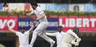 India's Umesh Yadav leaps in the air to celebrate the dismissal of South Africa's Quinton de Kock, right, during the third day of third and last cricket test match between India and South Africa in Ranchi, India, Monday, Oct. 21, 2019.
