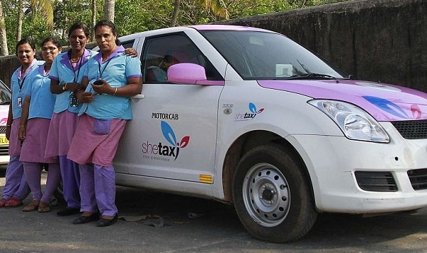 Female drivers from the 'She Taxi' service pose next to a taxi . Source: WOMENTAXIS REUTERS/Sivaram V.