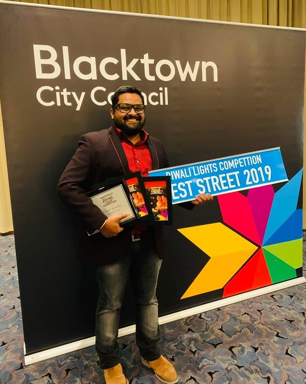 Apurv Kasoorkar with his plethora of awards at  Blacktown City Council's annual Diwali Lights Competition