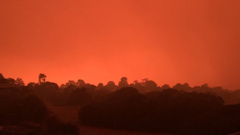 Orange sky and smoke in the air