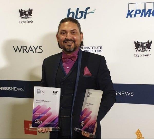 Nilesh Makwana, CEO of Illuminanace Solutions posing with his 2 awards at Business news' 40under40 ceremony.