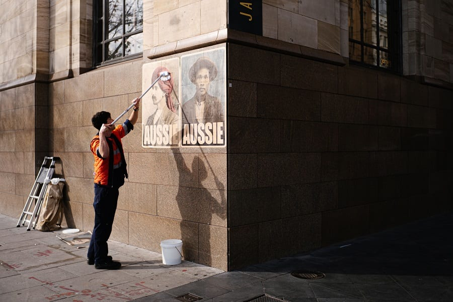peter drew putting up posters