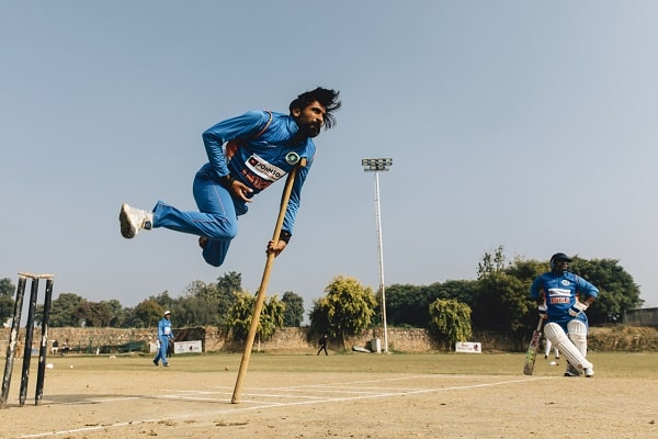 a physically challenged cricketer bowling