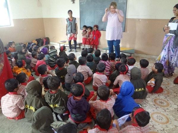 Melinda Parker singing with pre-primary kids at Gyanankur