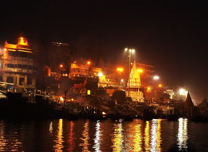 Hindu cremation being performed on the banks of the River Ganges in Varanasi, India