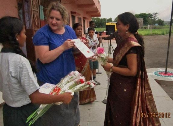 Melinda Parker distributes bouquets at Gyanankur in 2012