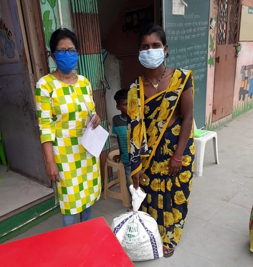 Parents receiving groceries donated through Gyanankur