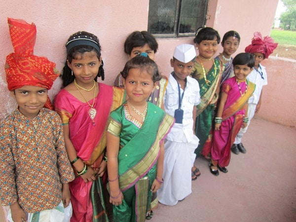 Gyanankur students stabnd in line, all dressed up for a school event