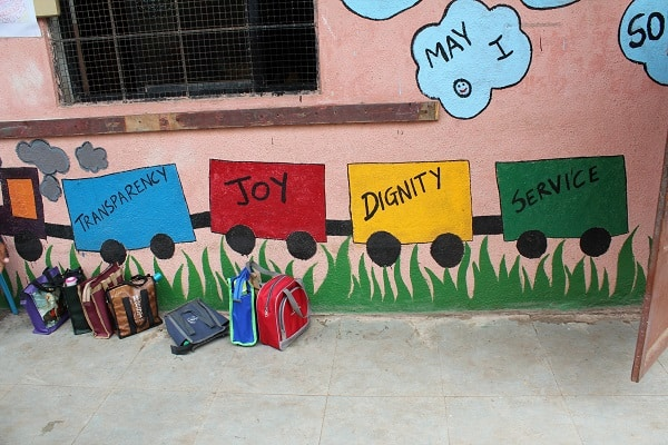 A wall painted with Gyanankur's core values of Transparency, Joy, Dignity and Service