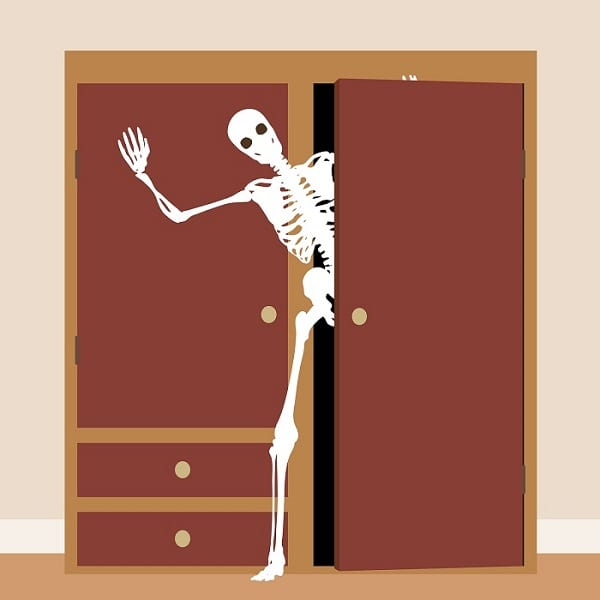 skeleton waving from a cupboard or clo
