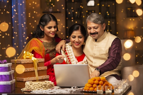 indian family looking at a laptop