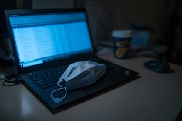 laptop and covid mask