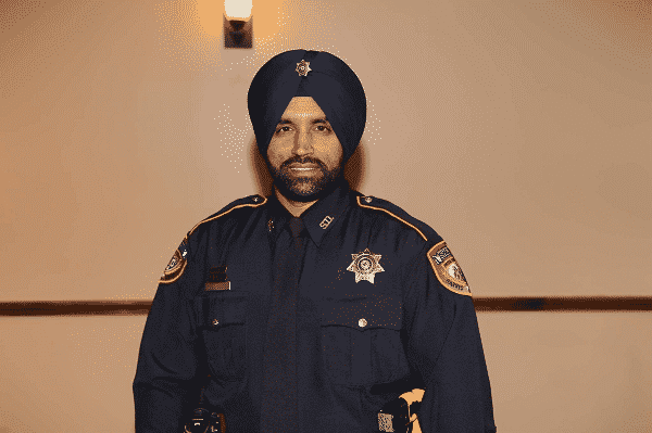 portrait of Deputy Sandeep Singh Dhaliwal in uniform.