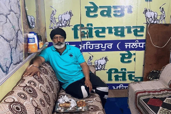 Harpreet Singh Mattu inside his container truck. Punjab farmer turns truck into makeshift home.