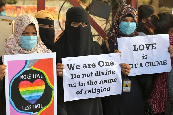 Activist protest against 'love jihad' laws being proposed in India.