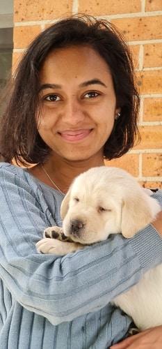 maya bhandari with puppy