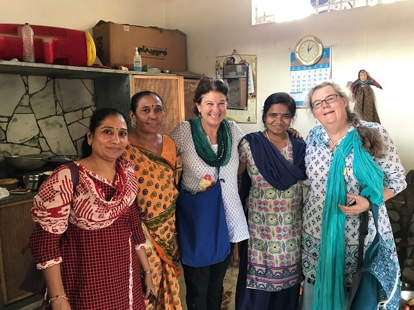jane and sarah with members of the community in ahmedabad