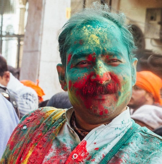 man with gulal colours