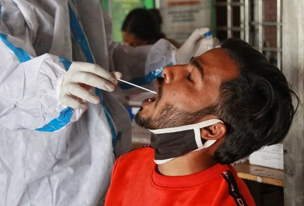 Man gets a covid test in India