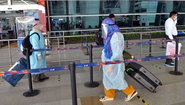 indians in ppe at airport