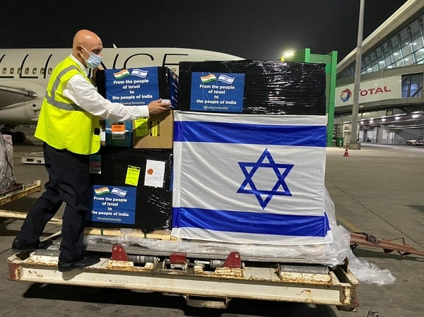 Israel's first consignment of oxygen generators arrives in Delhi.
