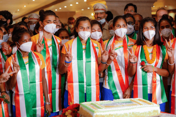 The national women's hockey team cutting a celebration cake at Hotel Ashoka after taking India to the semi-finals for the first time. Source: ANI