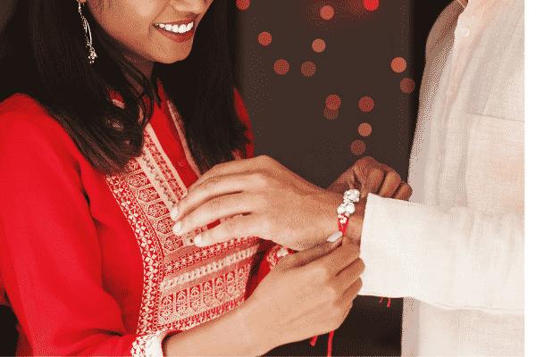 woman tying rakhi