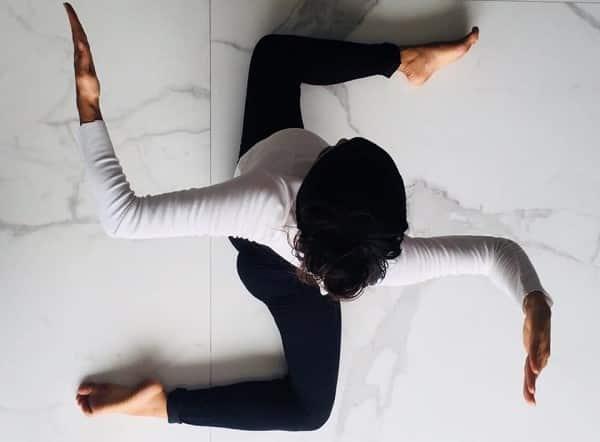 woman yoga swastika